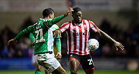 Lincoln City's John Akinde vies for possession with Yeovil Town's Josh Grant<br /> <br /> Photographer Chris Vaughan/CameraSport<br /> <br /> The EFL Sky Bet League Two - Lincoln City v Yeovil Town - Friday 8th March 2019 - Sincil Bank - Lincoln<br /> <br /> World Copyright © 2019 CameraSport. All rights reserved. 43 Linden Ave. Countesthorpe. Leicester. England. LE8 5PG - Tel: +44 (0) 116 277 4147 - admin@camerasport.com - www.camerasport.com