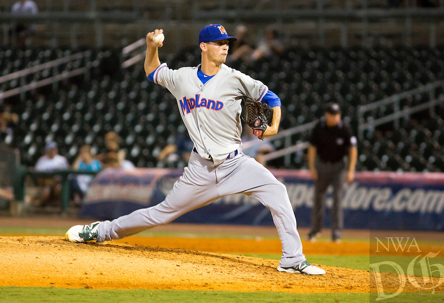 David Beach - Special to NWADG - Starting pitcher, Parker Frazier of the Rockhounds, pitches against the Naturals  at Arvest Ballpark, Springdale, AR on September 18, 2015