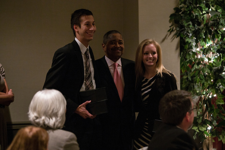 The first place recipients of a trip to implement a plan of their design to increase global well-being pose with President McDavis on Thursday, November 20, 2014 at the OU Inn. ©Ohio University / Photo by Katelyn Vancouver