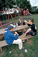 Group of underage teenagers drinking alcohol in a childrens playground. This image may only be used to portray the subject in a positive manner..©shoutpictures.com..john@shoutpictures.com