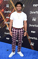 "LOS ANGELES - JULY 08: Cast member Isaiah John attends the Red Carpet Event for FX's ""Snowfall"" Season Three Premiere Screening at USC Bovard Auditorium on July 8, 2019 in Los Angeles, California. (Photo by Frank Micelotta/PictureGroup)"