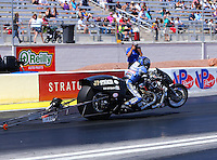 Apr 11, 2015; Las Vegas, NV, USA; NHRA top fuel Harley rider Takeshi Shigematsu during qualifying for the Summitracing.com Nationals at The Strip at Las Vegas Motor Speedway. Mandatory Credit: Mark J. Rebilas-