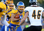 BROOKINGS, SD - SEPTEMBER 20:  Zach Zenner #31 from South Dakota State eyes the field as Levi Kossow #46 from Wisconsin-Oshkosh closes in during the first half of their game Saturday at Coughlin Alumni Stadium in Brookings. (Photo/Dave Eggen/Inertia)
