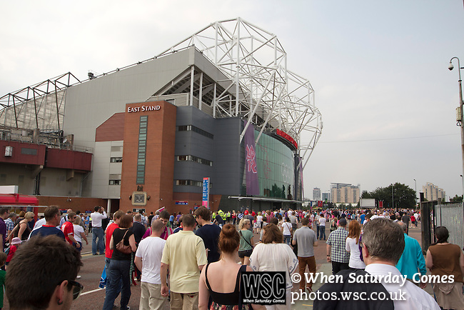 Uruguay 2 United Arab Emirates 1, Great Britain 1 Senegal 1, 26/07/2012. Old Trafford, Olympic Games. Spectators walking towards Manchester United's Old Trafford stadium prior to the Men's Olympic Football tournament matches at the venue. The double header of matches resulted in Uruguay defeating the United Arab Emirates by 2-1 while Great Britain and Senegal drew 1-1. Over 72,000 spectators attended the two Group A matches. Photo by Colin McPherson.