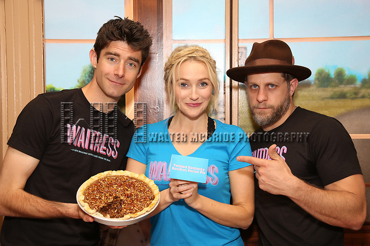 "Drew Gehling, Betsy Wolfe and Joe Tippett from the cast of ""Waitress"" ,with the winning pie Twisted Kentucky Bourbon Pecan Pie, celebrate 'Sugar, Butter, Flour: The Waitress Pie Cookbook at The Brooks Atkinson Theatre on June 27, 2017 in New York City."