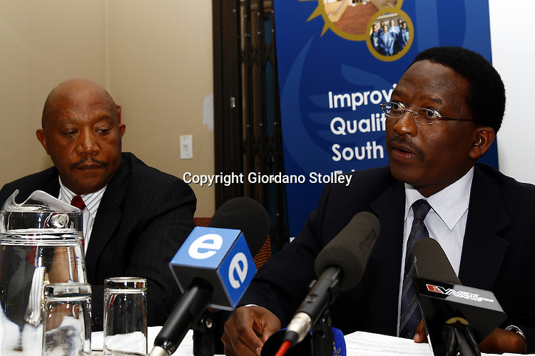PRETORIA - 30 December 2010 - Umalusi chairman Professor Sizwe (R) answers questions moments after Umalusi CEO Dr Mafu Rakometsi (Left) announced that Umalusi, the Council for Quality Assurance in General and Further Education and Training, has approved the release of the 2010 South African school leavers examination results. -- APP/Allied Picture Press