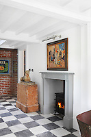 A welcoming fire burns in the stove of the entrance hall