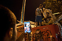 ISTANBUL, TURKEY-- JUNE 2, 2013-- A man photographs his friends on top of a commandeered Fox News van in Taksim Square on the 6th straight day of protests across the city. PHOTO BY JODI HILTON