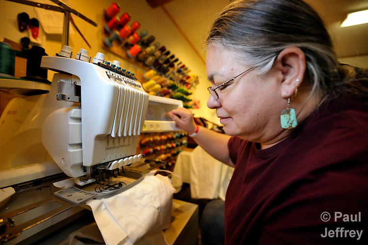 Quahlahtah Charcoal, 58, a Creek Cherokee woman from Evening Shade, Oklahoma, runs an embroidery machine at the Cookson Hills Center, a ministry of The United Methodist Church in Cookson, Oklahoma. The center produces liturgical stoles, altar cloths, and other items as a way to raise money for the center's ministries with poor families.