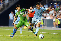 Omar Bravo (99) midfielder Sporting KC holds off the challenge from Fredy Montero (17) ) forward Seattle Sounders... Sporting Kansas City were defeated 1-2 by Seattle Sounders at LIVESTRONG Sporting Park, Kansas City, Kansas.