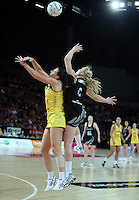 20.09.2012 Silver Ferns Laura Langman and Australian Natalie Von Bertouch in action during the second netball test match between the Silver Ferns and the Australian Diamonds played at Vector Arena in Auckland. Mandatory Photo Credit ©Michael Bradley.