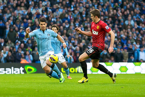 09.12.2012 Manchester, England. Manchester City's Argentinean forward Sergio Agüero and Manchester United's English midfielder Michael Carrick in action during the Premier League game between Manchester City and Manchester United from the Etihad Stadium. Manchester United scored a late winner to take the game 2-3.
