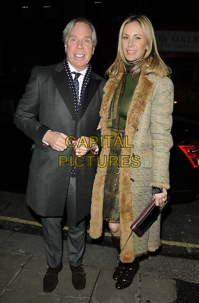 Tommy Hilfiger & Dee Ocleppo.The London Collections: Men GQ Dinner, Sketch bar & restaurant, Conduit St., London, England..January 9th, 2013.full length black jacket grey gray blue white polka dot scarf suit green dress beige fur coat married husband wife .CAP/CAN.©Can Nguyen/Capital Pictures.