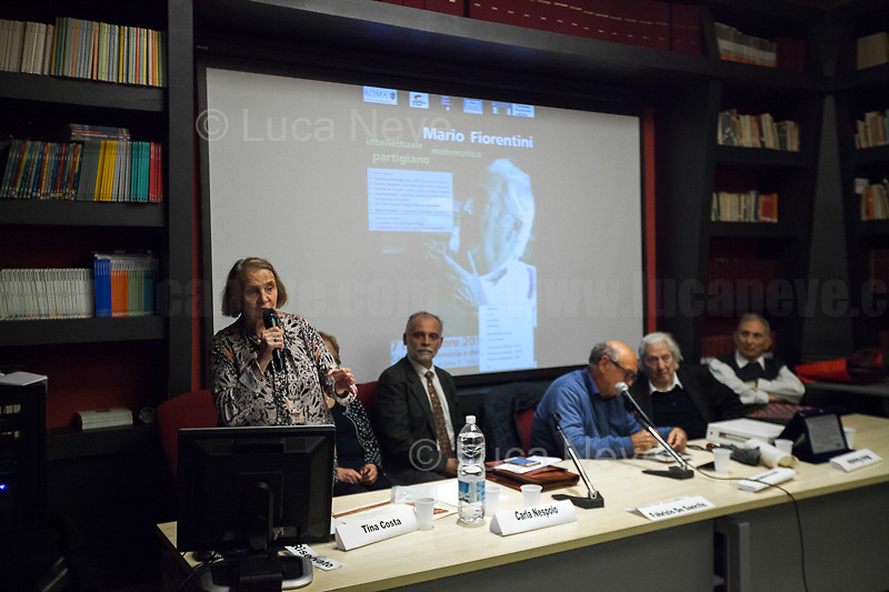 """Tina Costa (Antifascist Partizan. Member of the Partigiani: the Italian Resistance during WWII).<br /> <br /> Rome, 07/11/2018. Today, ANPI Roma (National Association of Italian Partizans, Members of the Italian Resistance) celebrated the 100th birthday of Partizan GAP Commander Prof. Mario Fiorentini holding a fully booked public event at the Casa della Memoria e della Storia di Roma (House of Memory and History of Rome). Mario Fiorentini (AKA, Giovanni, as the Apostle; Gandhi, due to be very skinny; Fringuello, due to a launch with a parachute; Dino, as he is called in Piedmont, https://bit.ly/2PL1IHn) was the Commander of the GAP """"Antonio Gramsci"""" in Rome. The GAPs - Gruppi di Azione Patriottica (Patriotic Action Groups, https://bit.ly/2K3jCmJ) were famous because their members, called """"Gappisti"""", carried out acts of sabotage & guerrilla warfare against nazi-fascist troups in cities such as Rome, Milan, Genova, Bologna and others. In Rome, Mario Fiorentini, along with his wife Lucia Ottobrini """"Maria"""" and other partizans, took part in numerous acts of guerrilla including the """"Attack of Via Rasella"""" on 23 March 1944 (Aredeatine Massacre on Wikipedia, https://bit.ly/2ASTk0a). The Man of """"Three Lives in One"""", as Mario Fiorentini is usually described: """"Humanist, GAP Partizan, Mathematician"""", was a roman communist intellectual member of a Jewish family who joined the Partizans Resistance (https://bit.ly/20uiWFf) after the 8 September 1943 Armistice. Subsequently the end of WWII, Mario, helped by his wife, studied maths becaming Professor of Superior Geometry at the University of Ferrara and a globally-known Mathematichian.<br /> <br /> More info about event & organisers: https://bit.ly/2D96uYA & https://bit.ly/2SUD3yZ<br /> ANSA Doc (in ITA) """"Mario e Lucia, di guerra e d'amore"""" https://bit.ly/1Dg7Ntj"""
