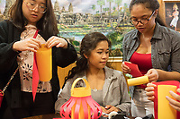 Cynthia Tim, 20, (from right), Socheata Mam, 19, and Sunwoo Kang, 22, create paper lantern crafts at a Lunar New Year celebration at Middlesex Community College's Asian American Connections Center on Thurs., Feb. 15, 2018. Tim is a Cambodian-American and a second year student at Middlesex Community College studying Business. Mam is a Cambodian-American first year student studying Criminal Justice. Kang is a foreign student from South Korea. The Asian American Connections Center was established at the school using a federal grant in 2016 and serves as a focal point for the Asian community at the school, predominantly Cambodian, to gather, socialize, study, and otherwise take part in student life.