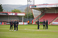 Grimsby players inspect the pitch ahead of the Sky Bet League 2 match between Cheltenham Town and Grimsby Town at the The LCI Rail Stadium,  Cheltenham, England on 17 April 2017. Photo by PRiME Media Images / Mark Hawkins.