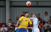 Lucas Paqueta of Brazil & Adam Armstrong (Barnsley, loan from Newcastle United) of England go up for the ball during the International match between England U20 and Brazil U20 at the Aggborough Stadium, Kidderminster, England on 4 September 2016. Photo by Andy Rowland / PRiME Media Images.