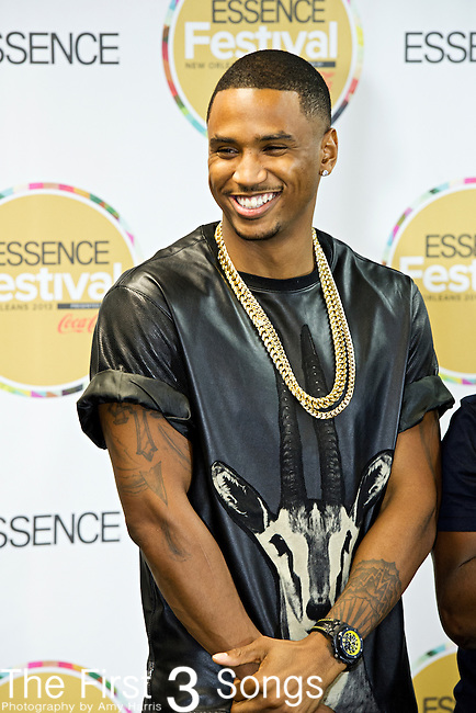 Trey Songz (born Tremaine Neverson) speaks with media at the 2013 Essence Festival at the Mercedes-Benz Superdome in New Orleans, Louisiana.