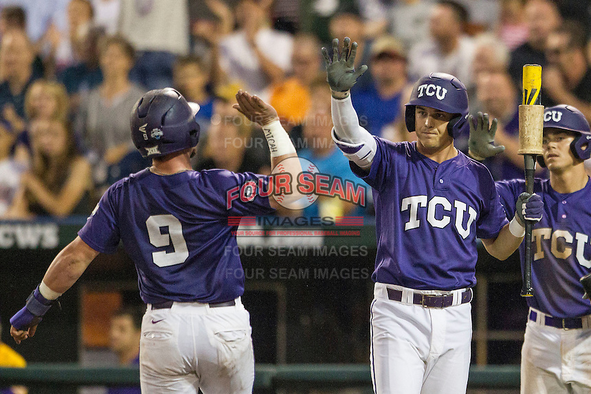 TCU Horned Frogs third baseman Derek Odell (5) greets teammate Evan Skoug (9) after he scores against the LSU Tigers in Game 10 of the NCAA College World Series on June 18, 2015 at TD Ameritrade Park in Omaha, Nebraska. TCU defeated the Tigers 8-4, eliminating LSU from the tournament. (Andrew Woolley/Four Seam Images)