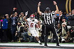 ATLANTA, GA - JANUARY 08: DeVonta Smith #6 of the Alabama Crimson Tide celebrates after catching the winning touchdown against the Georgia Bulldogs during the College Football Playoff National Championship held at Mercedes-Benz Stadium on January 8, 2018 in Atlanta, Georgia. Alabama defeated Georgia 26-23 for the national title. (Photo by Jamie Schwaberow/Getty Images)