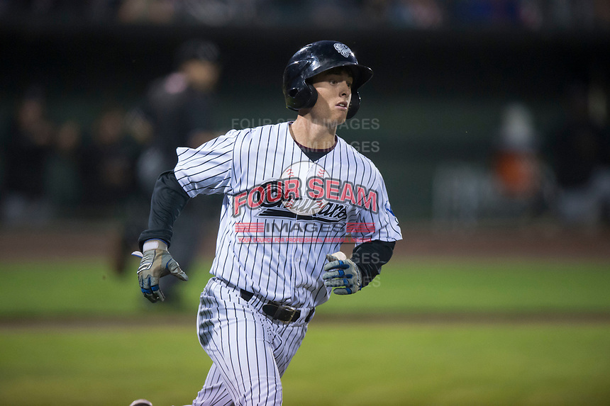 Idaho Falls Chukars left fielder Hunter Strong (3) begins to round first base during a Pioneer League game against the Billings Mustangs at Melaleuca Field on August 22, 2018 in Idaho Falls, Idaho. The Idaho Falls Chukars defeated the Billings Mustangs by a score of 5-3. (Zachary Lucy/Four Seam Images)