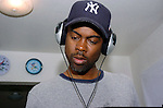Actor/Comedian Chris Rock checks out DJ equipment of  Hurricane Katrina evacuee Ronald Williams while on a visit to the Bonita House in Houston,Texas Thursday Sept. 29,2005.