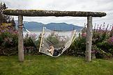 USA, Alaska, Homer, China Poot Bay, Kachemak Bay, children playing in a hammock at the Kachemak Bay Wilderness Lodge