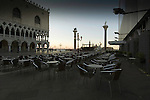 Empty chairs and tables ouside a café at dawn in St Marks square,Venice Italy