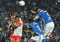 BOGOTA - COLOMBIA -16 -07-2017: Harold Santiago Mosquera (centro der), Andres Cadavid (Der) jugadores de Millonarios saltan por el balón con Victor Giraldo (Izq) jugador de Independiente Santa Fe durante partido partido por la fecha 2 de la Liga Aguila II 2017jugado en el estadio Nemesio Camacho El Campin de la ciudad de Bogota. / Harold Santiago Mosquera (Center  (R) and Andres Cadavid (R) players of Millonarios jumps for the ball with Victor Giraldo (L) player of Independiente Santa Fe during match for the date 2 of the Liga Aguila II 2017played at the Nemesio Camacho El Campin Stadium in Bogota city. Photo: VizzorImage / Gabriel Aponte / Staff.