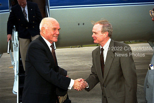 United States Senator John H. Glenn, Jr. (Democrat of Ohio), left, shakes hands with Kennedy Space Center (KSC) Director Roy Bridges shortly after Glenn's arrival at KSC's Shuttle Landing Facility on January 20, 1998 to tour KSC operational areas and to view the launch of STS-89 later this week.  Glenn, who made history in 1962 as the first American to orbit the Earth, completing three orbits in a five-hour flight aboard Friendship 7, will fly his second space mission aboard Space Shuttle Discovery this October. Glenn is retiring from the Senate at the end of this year and will be a payload specialist aboard STS-95..Credit: NASA via CNP