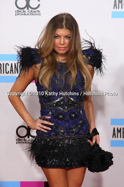 LOS ANGELES - NOV 21:  Fergie, aka Stacey Ferguson arrives at the 2010 American Music Awards at Nokia Theater on November 21, 2010 in Los Angeles, CA