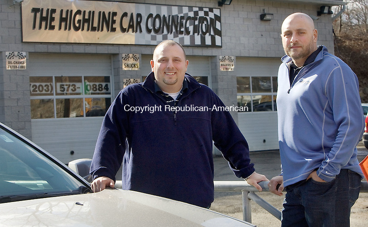 WATERBURY, CT. 07 February 2012-020712SV06-From left, Mike Cimino and Lou Persico, owners of The Highline Car Connection stand by a few cares for sale on their lot in Waterbury Tuesday. The used car dealership on Watertown Avenue has expanded by knocking down an adjacent restaurant and extending its showroom..Steven Valenti Republican-American