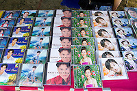 Rows of Hmong music CD disks for sale at concession stand. Hmong Sports Festival McMurray Field St Paul Minnesota USA