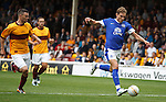 Nikica Jelavic nips through and slots the ball just past the post