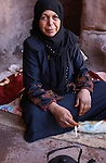 Portrait of a Bedouin woman in the ancient city of Petra, in Jordan. Petra is the most visited tourist attraction in Jordan, a symbol of the country for its historical and archaeological importance. It has been a UNESCO World Heritage Site since 1985. The Bedouin families that have been living for centuries in the caves of Petra, agreed to move out into a small village, built near the site of Petra.