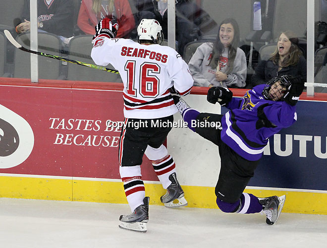 UNO's Johnnie Searfoss sends Minnesota State University-Mankato's Evan Mosey to the ice. (Photo by Michelle Bishop)