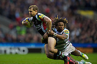 Nick Evans of Harlequins is tackled by Marland Yarde of London Irish  during the Aviva Premiership match between Harlequins and London Irish at Twickenham on Saturday 29th December 2012 (Photo by Rob Munro).