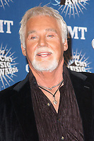 """20 March 2020 - Kenny Rogers, whose legendary music career spanned nearly six decades, has died at the age of 81. Rogers was inducted to the Country Music Hall of Fame in 2013."""" He had 24 No. 1 hits and through his career more than 50 million albums sold in the US alone. He was a six-time Country Music Awards winner and three-time Grammy Award winner. Some of his hits included """"Lady,"""" """"Lucille,"""" """"We've Got Tonight,"""" """"Islands In The Stream,"""" and """"Through the Years."""" His 1978 song """"The Gambler"""" inspired multiple TV movies, with Rogers as the main character. File Photo: 10 April 2006 - Nashville, Tennessee - Kenny Rogers. 2006 CMT Music Awards held at The Curb Event Center at Belmont University. Photo Credit: George Shepherd/AdMedia"""