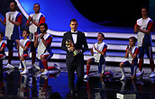 1st December 2017, State Kremlin Palace, Moscow, Russia;  World Cup record goal-scorer Miroslav Klose (C) from Germany carries the World Cup trophy to the stage as the representative of the current world champion during the FIFA 2018 World Cup draw, at the State Kremlin Palace in Moscow, Russia, 01 December 2017.