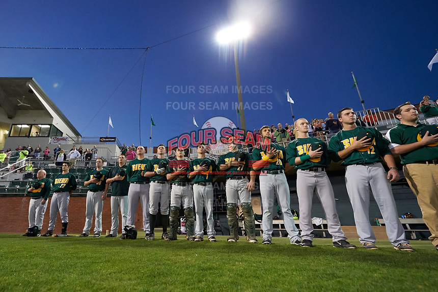 Siena Saints players, including Tony Rossi (40), Dan Swain (22), Joe Drpich (47), Phil Madonna (3), Tyler Matis (1), Patrick Ortland (27), Alex Tuccio (20), and Jordan Folgers (12), stand for the national anthem before a game against the Stetson Hatters on February 23, 2016 at Melching Field at Conrad Park in DeLand, Florida.  Stetson defeated Siena 5-3.  (Mike Janes/Four Seam Images)