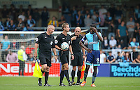Marcus Bean of Wycombe Wanderers appears to scratch his head at some of the decisions made by Referee John Brooks and his assistants during the Sky Bet League 2 match between Wycombe Wanderers and Colchester United at Adams Park, High Wycombe, England on 27 August 2016. Photo by Andy Rowland.