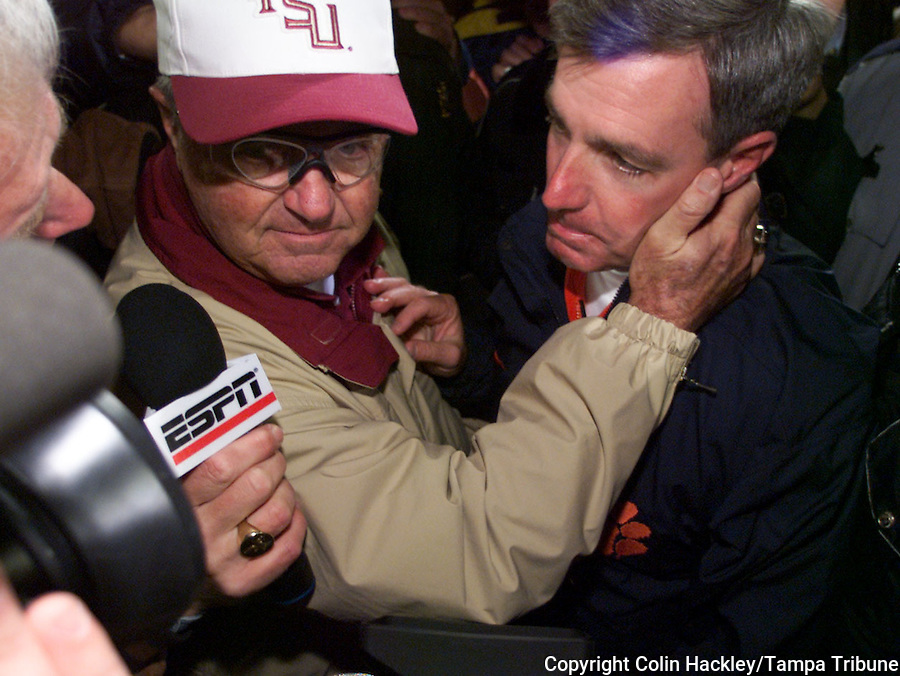 CLEMSON, S.C. 10/23/99-FSU Coach Bobby Bowden, left, consoles his son Tommy Bowden, coach of Clemson after FSU defeated Clemson 17-14Saturday at Frank Howard Field in Clemson, S.C. ..COLIN HACKLEY PHOTO