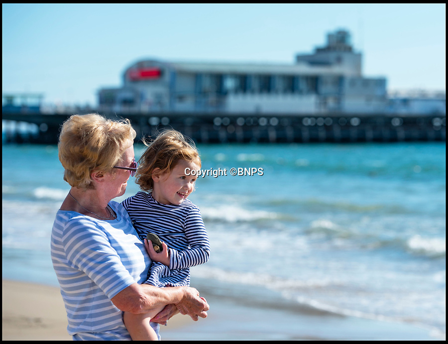 BNPS.co.uk (01202 558833)<br /> Pic: RogerArbon/BNPS<br /> <br /> Maureen Toolan with granddaughter Darcy Toolan (3).<br /> <br /> It's red hot October!<br /> <br /> Unseasonably warm weather draws people to Bournemouth beach to soak up the last of the summer rays.