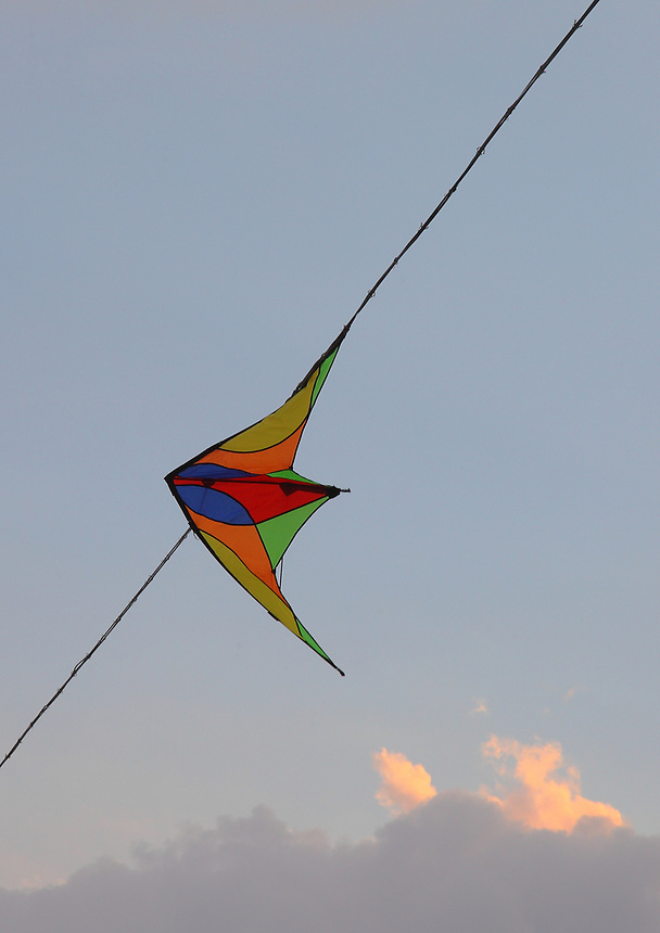 Here, a coloured kit against the background of a beautiful, limpid sky, with some clouds. It got caught on a light cable. The photo has been taken in a sunny summer evening, in the province of Rieti, near the boundary between Lazio and Abruzzo. This is an enlargement of a part of the original image.