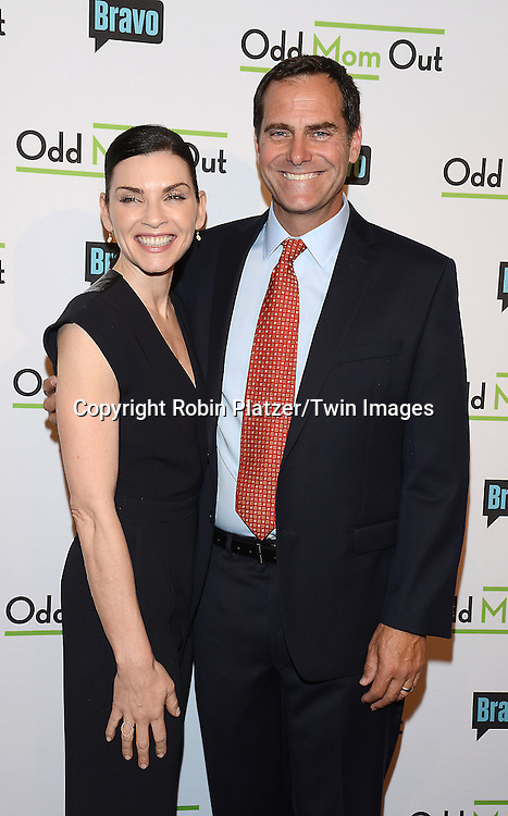 Julianna Margulies and Andy Buckley  attend the &quot;Odd Mom Out&quot; Screening, which is Bravo's first scripted half-hour comedy from Jill Kargman,  on June 3, 2015 at Florence Gould Hall in New York City, New York, USA.<br /> <br /> photo by Robin Platzer/Twin Images<br />  <br /> phone number 212-935-0770