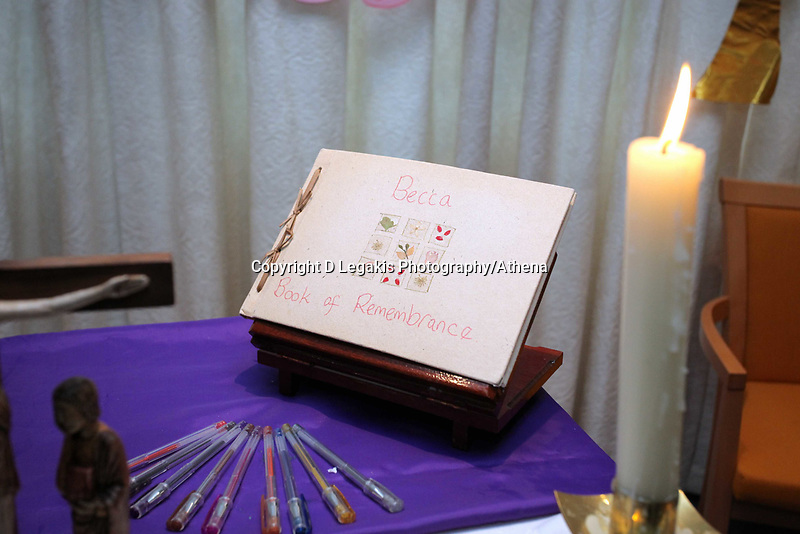 Pictured: A book of rememberance and tributes have been set at Archbishop McGrath Catholic School where Rebecca Aylward was a pupil by her headteacher Rev Dr Philip Manghan, although the school is closed for half term. <br /> Wednesday 27 October 2010<br /> Re: South Wales Police are investigating the murder of fifteen year old Rebecca Aylward from Maesteg, whose body was discovered in woods in Aberkenfig near Bridgend south Wales. A fisteen year old man who cannot be named for legal reasons has appeared at Bridgend Magistrates court this morning.