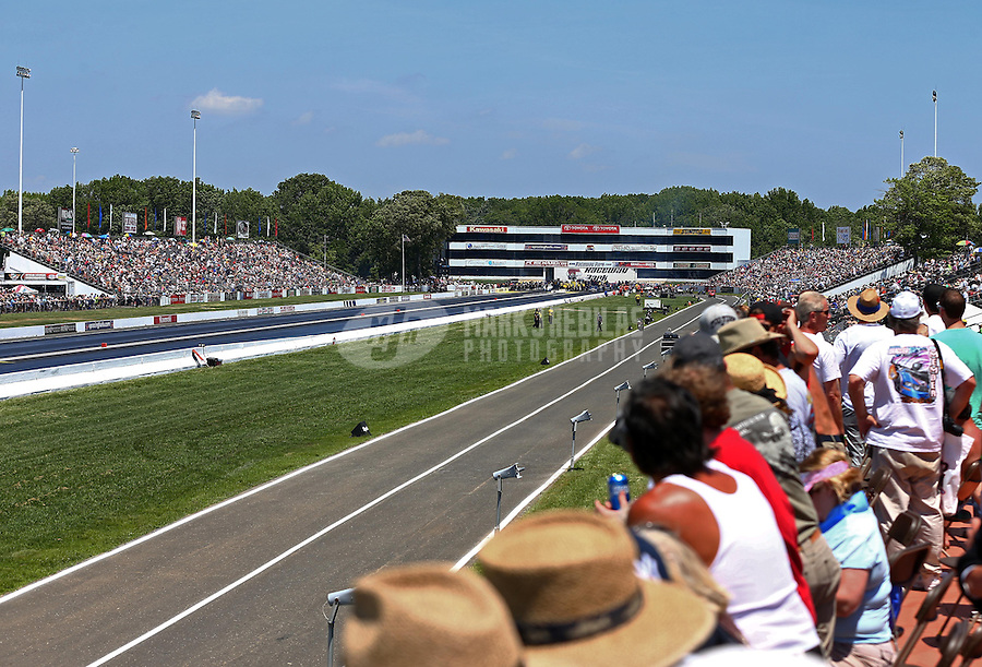 Jun. 1, 2013; Englishtown, NJ, USA: Overall view of Raceway Park and the grandstands during qualifying for the Summer Nationals. Mandatory Credit: Mark J. Rebilas-