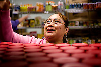 Volunteer Maria Martinez (cq) gets cans of peanut butter off the shelf at Central Dallas Ministries in Dallas, Texas, Tuesday, March 18, 2007. Central Dallas Ministries food bank uses volunteers to give donated food to people in need. ..PHOTO/MATT NAGER