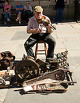 One man band busker musician, Abbey churchyard, Bath