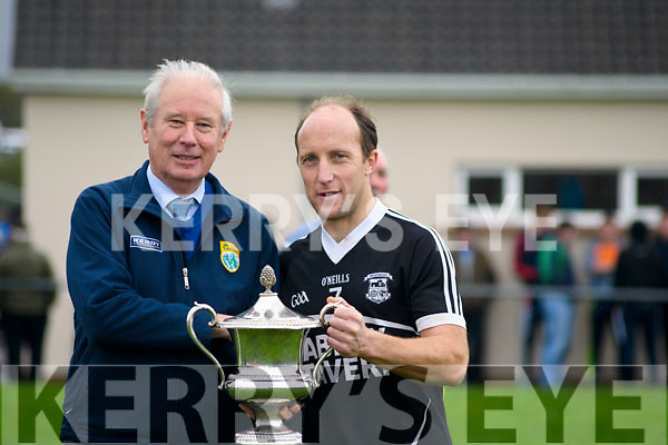 Victorious Ardfert Captain, Niall Clifford, receives The Barrett Cup trophy from Kerry County Board member, Christy Killeen after securing a 2-11 to 1-12 win over St. Michaels-Foilmore in a thrilling and hard fought battle in the Junior Football Final.